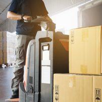 conductor-montacargas-cargando-mercancias-envio-palets-camion_36860-728
